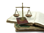 Weighing scales and books — Stock Photo
