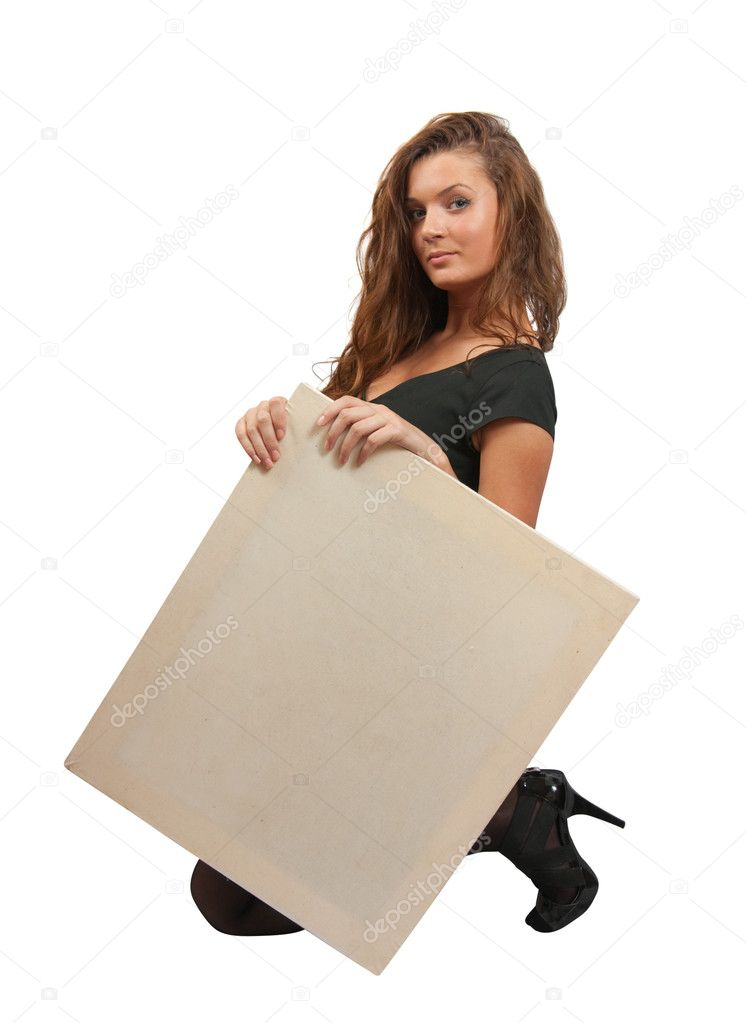 Standing long haired girl in holds an empty poster  Stock Photo #3167674