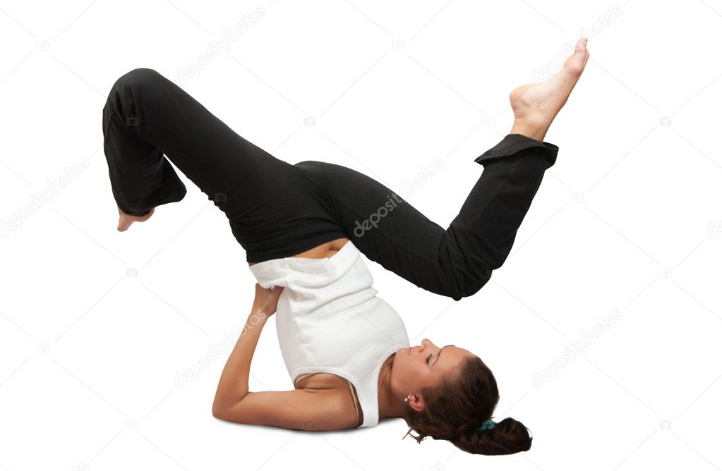 Fit brunette in black sportswear practicing yoga over white — Stock Photo #3167864