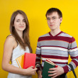 Two students with books — Stock Photo