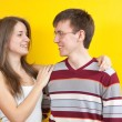 Happy couple on  yellow — Stock Photo