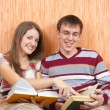 Joy students with books at home — Stock Photo