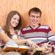 Joy students with books at home — Stock Photo #3170611
