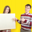 Nice teens with banner — Stock Photo #3171009