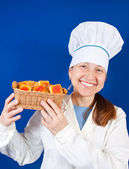 Portrait of female cook with cookie — Stock Photo