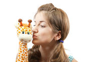 Young girl in green with soft toy — Stock Photo