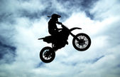 Moto racer in sky — Stock Photo