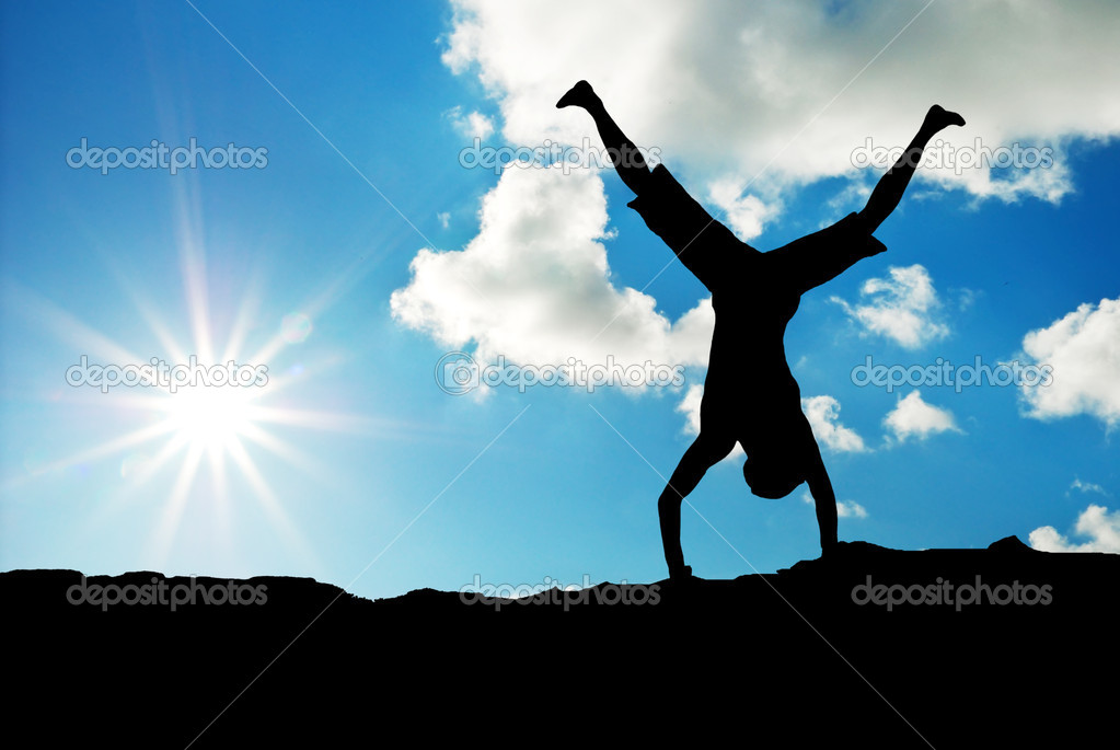 Happy acrobat on the sunset. Emotional scene.  Stock Photo #3528851