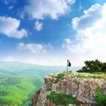 Girl on the peak of mountain — Stock Photo #3630988