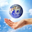 Planet Earth and human hand — Stock Photo