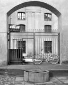 Bicycle of the monk at monastery gate — Stock Photo