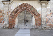 Ancient franciscans church gate — Stock Photo