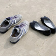 Shoes on beach sand — Stock Photo