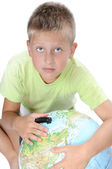 Boys pointing on world globe — Stock Photo