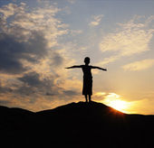 Silhouette of young person on mountain — Stock Photo