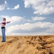 Attractive woman standing in desert — Stock Photo