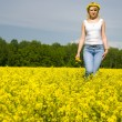 Blond woman outdoor in a yellow field — Stock Photo