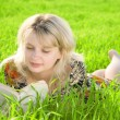 Royalty-Free Stock Photo: Young beautiful girl reading a book outdoor