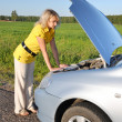 Young womin her car breaks down. Engine failure — Stock Photo #3422005