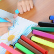 Child draws is family on white paper — Stock Photo #3432313