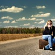 Pretty girl waiting on the road — Stock Photo