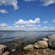 Stony shore of lake — Stock Photo