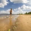 Young boy running at the beautiful beach — Stockfoto