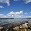 Stony shore of lake - Stock Photo