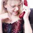 Royalty-Free Stock Photo: Portrait of secretary screaming in telephone receiver