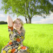 Stock Photo: Lovely young girl relaxing on a meadow