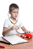 Cute young boy playing doctor — Stock Photo