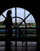 Silhouette woman opposite window railway station — Foto de Stock