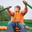 Young man rowing a boat — Stock Photo