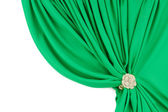 Green silk curtains with a clip — Stock Photo