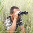 Stock Photo: Border war is looking through binoculars