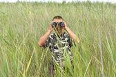 A border war is looking through binoculars — Stock Photo
