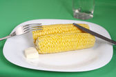 Boiled corn cob with butter — Stock Photo