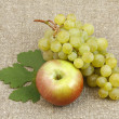 Bunch of white grapes and apples on background of matting — Stock Photo #3712663