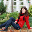 Stok fotoğraf: Beautiful girl sits on lawn