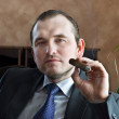 Stock Photo: Young mwith cigar