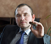 Young man with cigar — Stock Photo