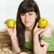 Young woman with apples — Stock Photo