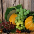 Three pumpkins and berries - Stock Photo