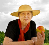 Happy senior woman outdoors — Stock Photo