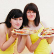 Stock Photo: Two young woman eating