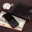 Purse money hours mobile phone — Stock Photo #3454139