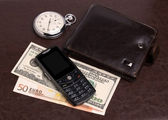 Purse money hours mobile phone — Stock Photo