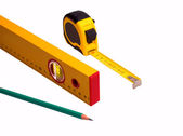 Measuring tape, pencil and level — Stock Photo