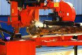 Sawmill cuts a log. — Stock Photo