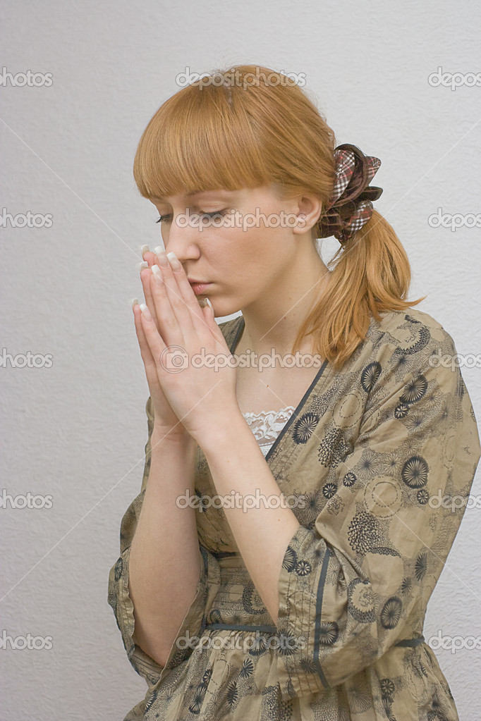 Young female praying  Stock Photo #2928825